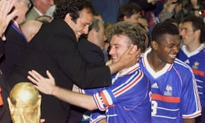 Captain Didier Deschamps receives the World Cup from Michel Platini in 1998, closely followed by friend and teammate Marcel Desailly