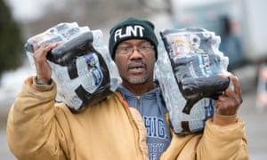 Steve Deloney carries water which he was using for himself and delivering to his sister.