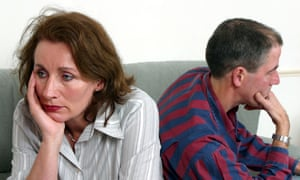 Adult couple with mid life problems sitting on the sofa back to back SerieCVS117004BCC5MK Adult couple with mid life problems sitting on the sofa back to back SerieCVS117004