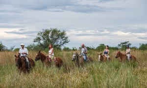 Horse riding in the wetlands, Ibera, Argentina.