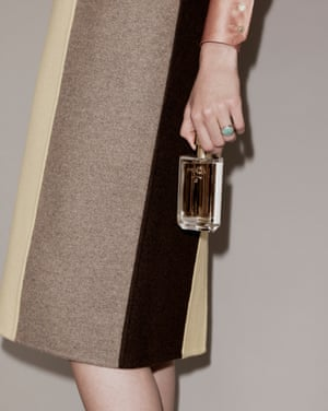 Prada La Femme and L'Homme, £99, available nationwideBlouse by Lanvin from . Skirt by Marni. Ring by Monica Vinader