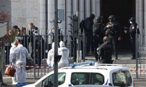 French members of the elite tactical police unit RAID enter to search the Basilica of Notre-Dame de Nice as forensics officers wait outside.