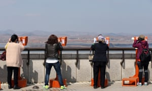 Tourists in South Korea look into the North from the border city of Paju.