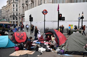 Activists eat breakfast on the morning of a second day at Oxford Circus
