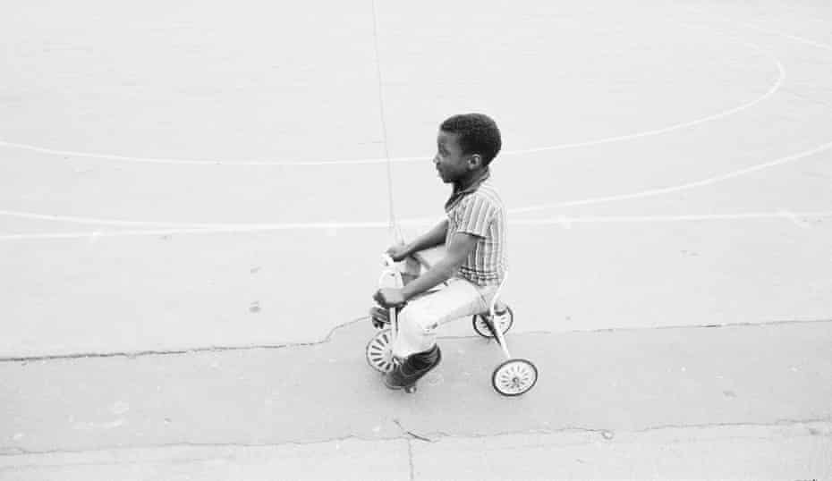 Boy on a tricycle.