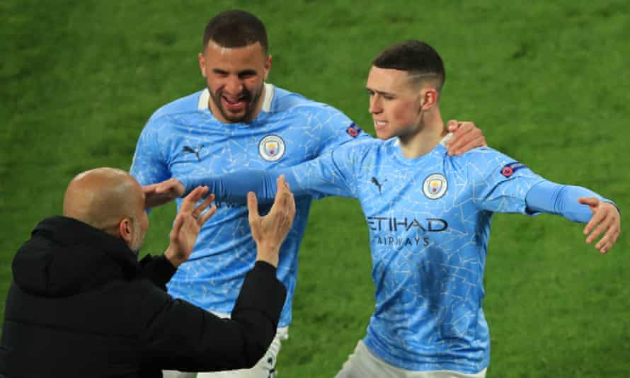 Pep Guardiola celebrates with Phil Foden (right) and Kyle Walker.