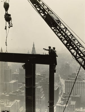 Derrick and workers on girder, Empire State Building, 1930-31 In Hine's vertiginous series of photos of the Empire State Building's construction, he shot men performing perilous tasks perched on beams and hanging from wires. Times' art critic Ken Johnson once wrote the photographs reflect Hine's 'romantic belief in the possibilities of America'