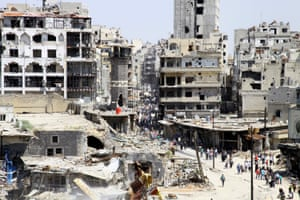 Residents arrive to inspect their homes, after the cessation of fighting between rebels and forces loyal to Syria's President Bashar al-Assad.