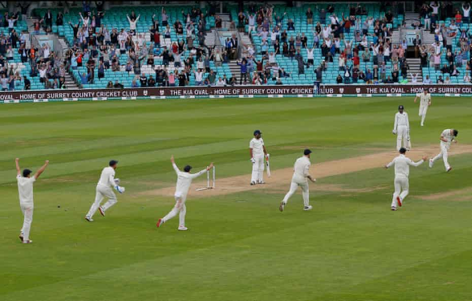 Jimmy Anderson of England (far right) bowls Mohammed Shami to end the match and also become the highest test match wicket-taking fast bowler of all time during the 5th day of the England v India 5th test match at the Kia Oval in September 2018