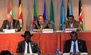 South Sudan's President Salva Kiir (bottom left) and South Sudan's rebel commander Riek Machar (bottom right) attend the signing of a ceasefire agreement in Ethiopia's capital, Addis Ababa, 1 February 2015