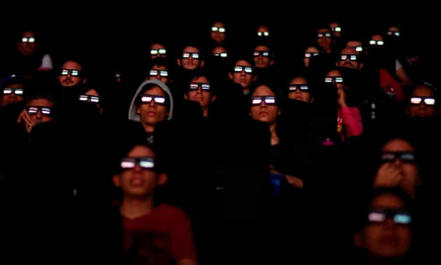 Venezuelan filmgoers watch the first screening of Avengers: Endgame in Caracas.