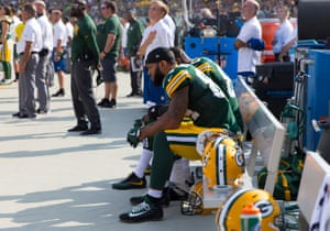 Green Bay Packers tight end Lance Kendricks (84) and tight end Martellus Bennett (80) sit on the bench during the national anthem prior to the game against the Cincinnati Bengals at Lambeau Field.