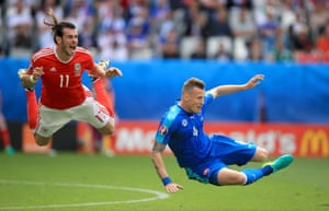 Gareth Bale goes down after a challenge from Slovakia's Jan Durica.