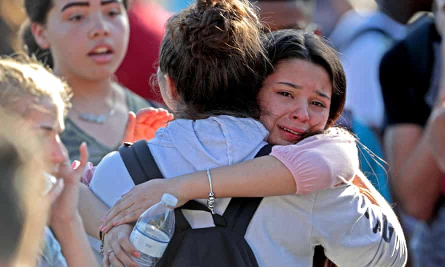 Students are released from lockdown on 14 February at Marjory Stoneman Douglas High School in Parkland, Florida.