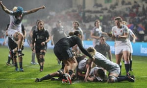 England players celebrate as Marlie Packer, grounded, scores a try