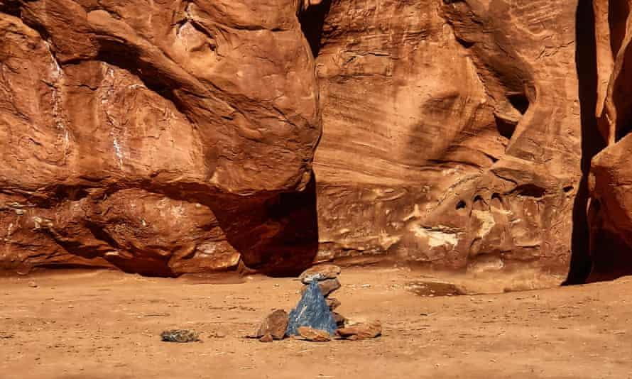 Rocks mark the location where a metal monolith once stood in the ground in a remote area of red rock in Spanish Valley, Utah, south of Moab near Canyonlands national park.