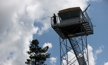 Nick Dutton surveys the landscape at the Kowen Forest fire tower near Canberra.