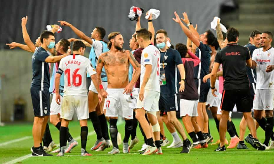 Sevilla celebrate wildly after their win over Manchester United.