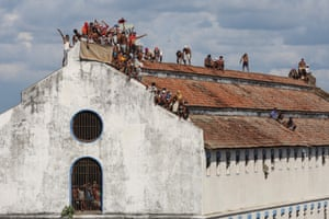 Colombo, Sri LankaA group of prisoners protest atop the roof of the Welikada Remand prison demanding they be granted bail due to Covid-19 positive cases within prisons