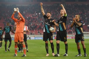 Petr Cech, Per Mertesacker, Olivier Giroud, and Theo Walcott of Arsenal celebrate at the end of the match.