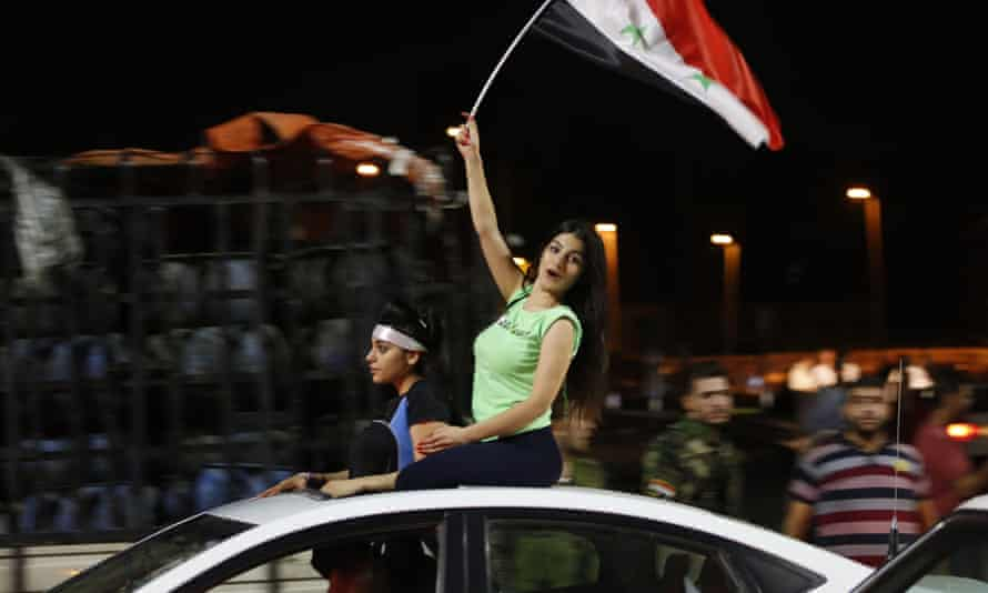 Syrians celebrate in Damascus after the game.