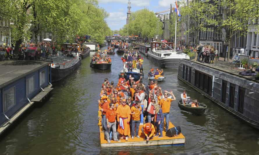 People celebrate King's Day on one of Amsterdam's famous waterways.