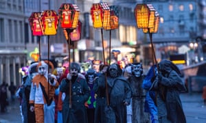 Carnival revellers parade through the streets of Basel. The city prides itself of being a safe haven for rebels and free thinkers.