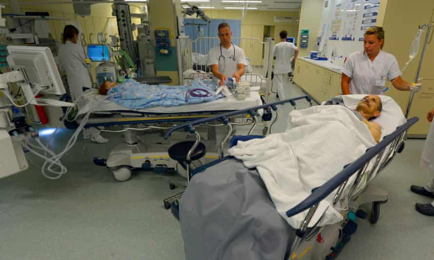 Doctors tend to patients at the UKB hospital in Marzahn district in Berlin, Germany.