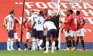 Anthony Martial is shown a red card after lashing out at Erik Lamela