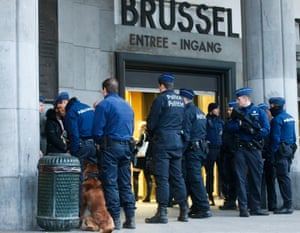 Police check and arrest people in front of Brussels central station in Brussels