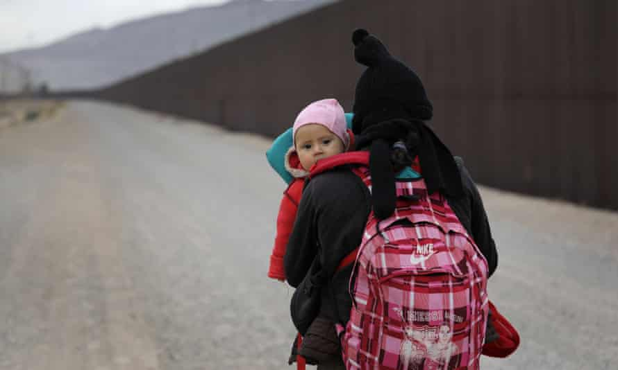 A Central American woman walks along the border in El Paso, Texas on 1 February.