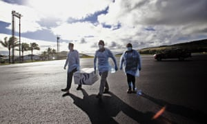Health workers unload CoronaVac vaccines developed by Sinovac on their arrival at Easter Island International Airport, in Rapa Nui, Chile on 4 February 2021.