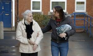 Two women outside a building