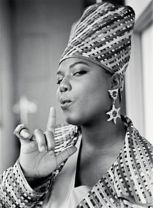 "Queen Latifah, New York City, 1991. Says photographer Al Pereira: ""I believe the artist's ideas inform their image, so I love collaboration. It was actually her idea to do the smoking gun kind of pose. She did all the heavy lifting with that shot and really brought power to it. Dana was always a visual person and understood the power of media and photography. She was an unapologetic champion for black feminism, pride and Afrocentrism, and it was all expressed in her lyrics, her style and her media image. She was the Queen in command."""