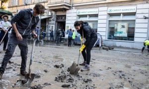 People clean up after the floods in Ventimiglia in northern Italy
