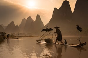 Beautiful pictures show the breathtaking tranquility of Chinese rivers as fishermen use birds to catch their prey