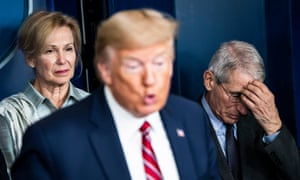 Fauci with Trump and Deborah Birx at the White House taskforce briefing in March.