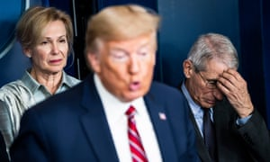 Dr Anthony Fauci (right) behind then-US president Donald Trump in March 2020.