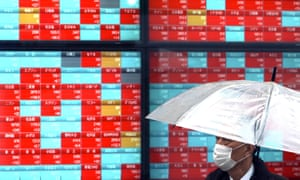 An electronic stock board showing Japan's Nikkei 225 index at a securities firm in Tokyo today