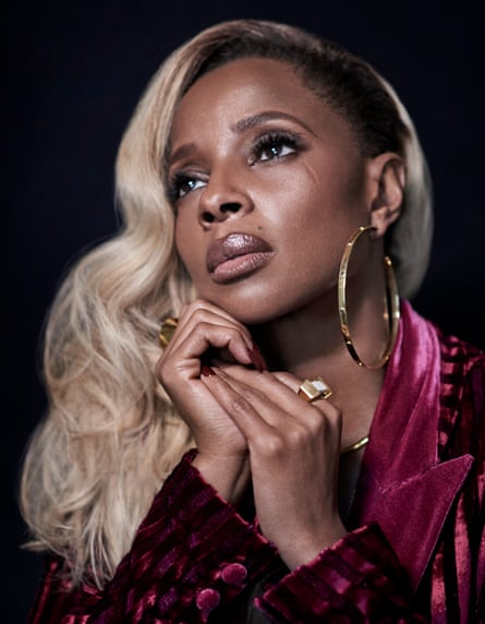 Mary J Blige in close-up, clasping her hands together, looking anxious