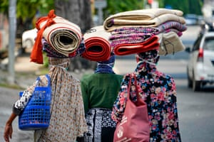 Banda Aceh, Indonesia Women carry woven mats that are for sale, on their heads