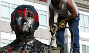 A worker frees with a drill a bust of Spanish dictator Francisco Franco from its plinth prior its removal in the central square of the Spanish northwestern village of Ponteareas, 2003.