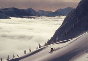 Skier skiing fresh powder in backcountry near Fernie, East Kootenays, British Columbia, Canada.