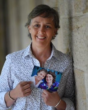 Jill Kindt holds a photo of her with her late wife, Jo Grant, at Parliament House in Brisbane.