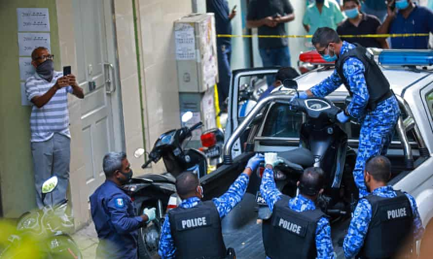 Maldives police personnel impound a scooter belonging to a suspected terrorist in connection with the blast in Male.