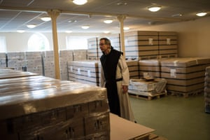 Father Joseph inspects the storage room