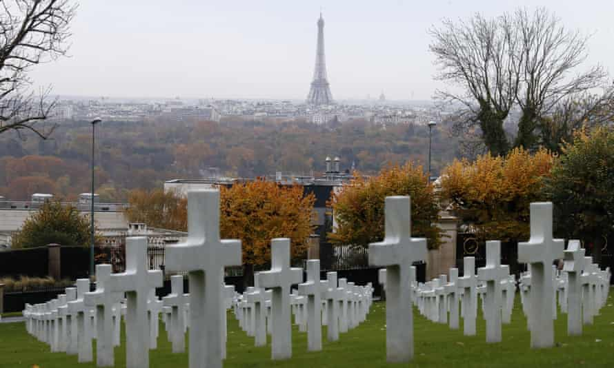 The Eiffel Tower looms in the background of the headstones during a commemoration ceremony at Suresnes cemetery.