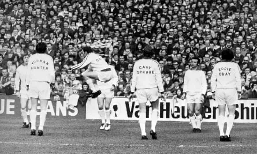 Cooper jumps in the air during Leeds' warm-up before an FA Cup sixth-round match against Spurs.