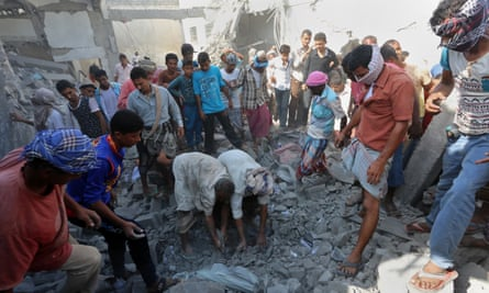 People search for survivors under rubble at the prison complex