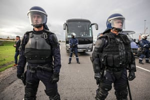 Setubal, Portugal Police officers escort a busload of workers due to replace dockers who have been on strike since 5 November.